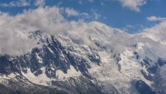 Mont Blanc mountain peak and glaciers covered in clouds time lapse 4K Stock Footage