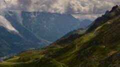 Alpine trails going down to Chamonix valley, Mont Blanc in distance time lapse Stock Footage