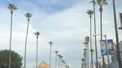 Day Driving shot California Palm trees signs Ventura Boulevard BLVD Los Angeles Stock Footage