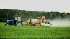 Tractors sprayed with fertilizer grass on the field Stock Footage