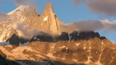 Chamonix Aguille du Dru fog lifting time lapse sunset Stock Footage