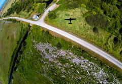 Aerial view of a small plane shadow during landing - stock photo