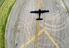 Aerial view of a small plane shadow during landing, BC Canada - stock photo