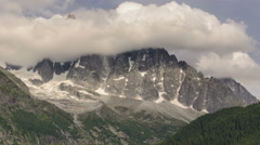 Aguille du Dru north face hidden in clouds time lapse Stock Footage