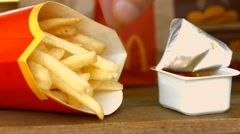 Restaurant Mc'Donalds. French fries, fast food restaurant Stock Footage