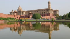 Central Secretariat with reflection in pond,New Delhi,India Stock Footage