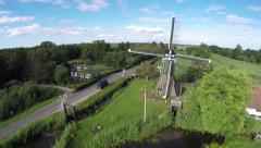 Aerial drone flying around Dutch windmill front to back 4k Stock Footage