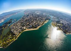 Aerial view of downtown Vancouver with English Bay in foreground, BC Canada - stock photo