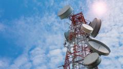time lapse antenna communication tower and blue sky (zoom out) - stock footage