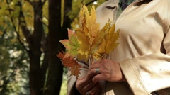 Woman With A Bouquet Of Leaves - stock footage