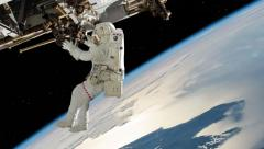 Astronaut working on International space station Stock Footage