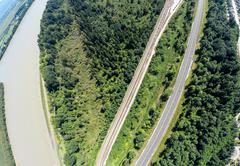 Aerial view of railroad and highway, BC Canada - stock photo