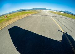 Aerial view of small plane shadow during takeoff, BC Canada - stock photo