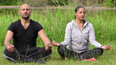 Young Couple in Nature Funny Meditation Moment Stock Footage