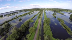 Flying over windmill drone flying over Dutch dike swamp lake water peatland turf Stock Footage