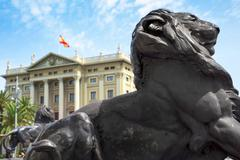 bronze lion at the base of the Columbus Monument in Barcelona, Spain - stock photo
