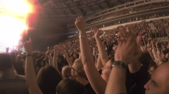 Crowd applauding in euphoria, clapping in tune with popular song during concert - stock footage