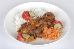 Traditional Indian Mutton Curry with Rice and Salads - stock photo