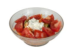 Bowl of Tomato Based Salad Accompaniment for Indian Curry Stock Photos