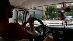 Man Driving Old Car Vintage Taxi City Traffic Havana Cuba - stock footage