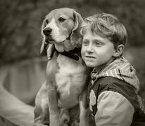 Boy with beagle portrait - stock photo