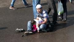 Street beggar on muslim holiday Eid al-Fitr (Uraza-Bairam). Crowd of migrants - stock footage