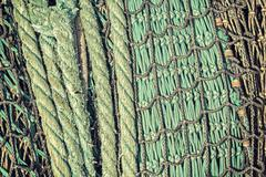 Retro vintage filtered abstract background made of fishing net. Kuvituskuvat