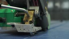 Machine glueing the side of the handball court Stock Footage