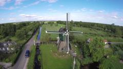 Drone aerial flying towards Dutch windmill 4k - stock footage