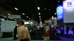 Wide panning shot of conference trade show floor Stock Footage