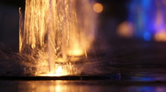 Colorful fountain at night close-up Stock Footage
