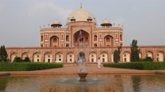 Humayun's Tomb with fountain with man,New Delhi,India Stock Footage