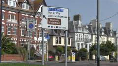 Road Directions Out of City M275 Brown Tourist Information Sign in Southsea P Stock Footage