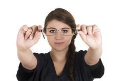 Beautiful young brunette girl intern doctor pediatrician nurse - stock photo