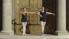 Stock Video Footage of Ballerinas Practice Jump In Elegant Doorway, They Look At Each Other And Laugh