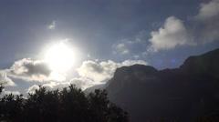 4k Clouds timelapse deep sun over mountain peaks Stock Footage