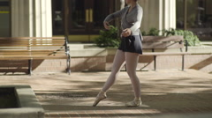 Beautiful Ballet Dancer Practices Her Turns/Spins In City Square (Slow Motion) Stock Footage