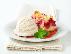 Berry fruit crumble slice with ice cream and raspberry sauce - stock photo