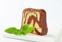 Marble pound cake with chocolate glaze - stock photo