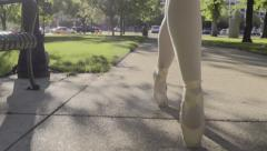 Ballerina's Feet As She Walks In City Park, She Dances En Pointe (Slow Motion) Stock Footage
