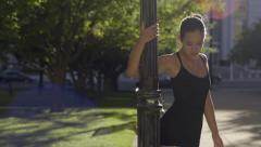 Passionate Ballerina Dances En Pointe In City Park Against A Lamp Post Stock Footage