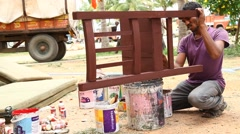 Man painting the chair Stock Footage