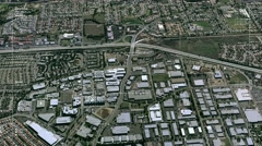 Aerial surveillance flyover of a freeway interchange Stock Footage