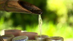 Japanese bamboo water fountain at the entrance of a temple - stock footage