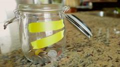 Money Filling Jar Timelapse - stock footage