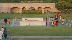 People paying respect at Raj Ghat where Gandhi was cremated,New Delhi,India Stock Footage