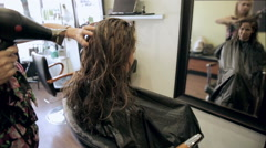 Gorgeous Woman in Beauty Salon having Hair Blow-Dried by Stylist in Mirror Audio Stock Footage