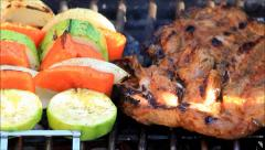 Vegetable Kabobs and steak on the Barbecue Stock Footage