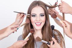 Closeup of beautiful blond girl getting hair and makeup done Stock Photos