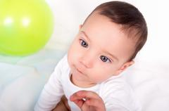 Thoughtful cute baby boy with an intense concentrated look Stock Photos